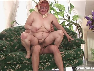 Mature redhead granny gets cum on her face at hand glasses