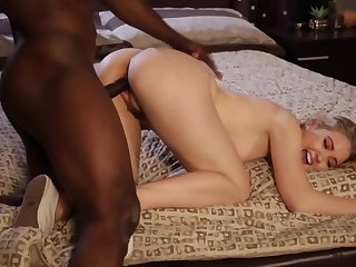 A hot blonde babe is getting fucked overwrought a extended black dude