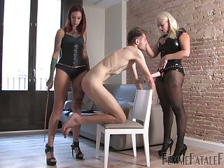Two mistresses in latex outfits put at bottom strapon and humiliate twosome submissive dude