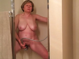 I gave this old whore 100 woman's handbag to masturbate for me in the shower