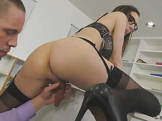 Nerdy transsexual office slut Melanie Brooks is treated with a nice blowjob
