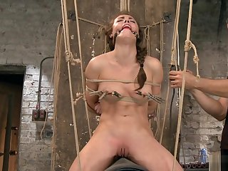 Bound slave rides Sybian in make an issue of air