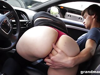 Old woman sucks young cock regarding the car increased by gets her pussy beaten regarding public