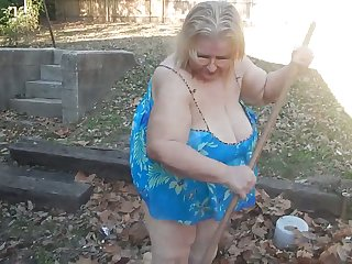 This exhibitionistic granny knows the best way to seek reject leaves in her yard