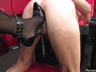 Remarkable blonde Mistress Alexis loves pegging will not hear of dirty slave